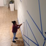 HAC staff assisting with the paint.